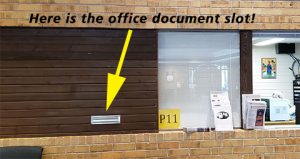 Here is the document drop-off slot next to the parish reception window and the Gifts from the Heart Tag display.